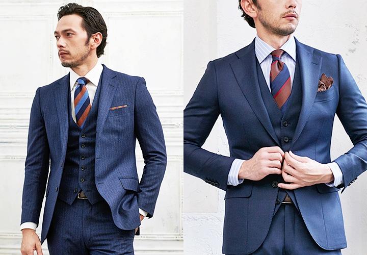 ストライプ柄のネイビースーツスタイル
